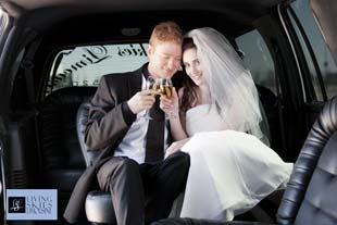 Wedding couple in limo